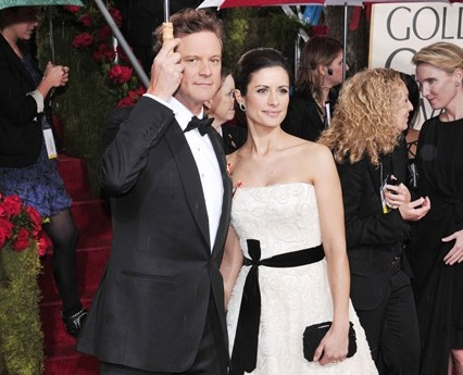Livia Firth with husband Colin wearing her 'upcycled' wedding dress to the 2010 Golden Globe Awards Ceremony.