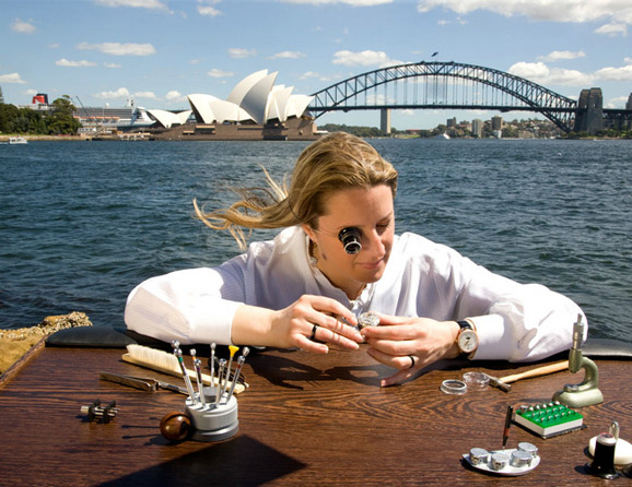 Girard-Perregaux's ad campaign challenges stereotypes about watchmakers. Here, one of its young employees is hard at work against the stunning backdrop of the Sydney Harbour. Photo courtesy Girard-Perregaux.