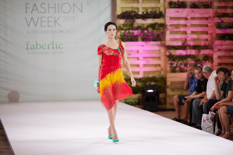 Model at the 2013 Russian Eco Fashion Week wearing a silk and felt dress by designer Alena Permikina.
