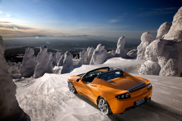 Tesla Roadster in Very Orange, the world's first zero-emissions luxury racing car.