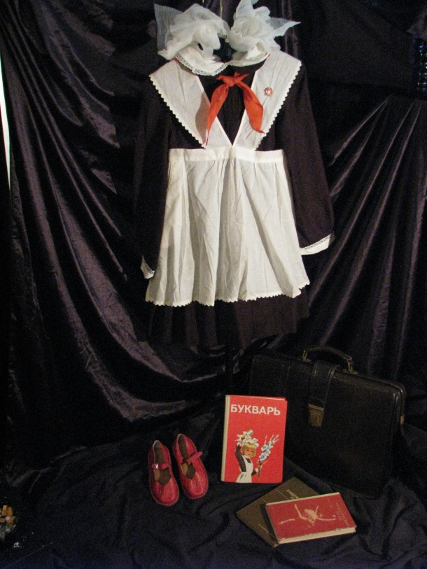 Classic Soviet school uniform for girls. Photo via Frank Vjecy's Soviet Life Collection.