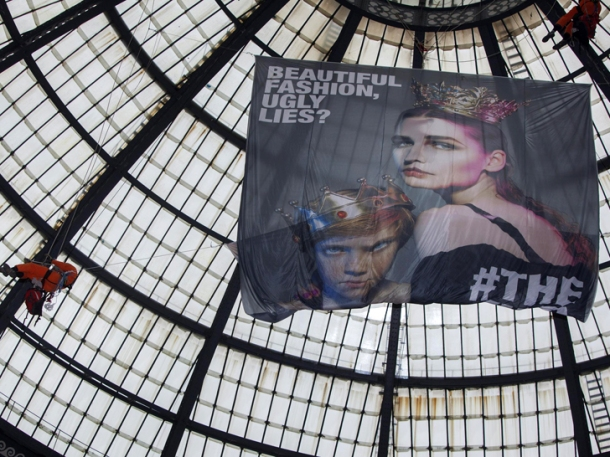 Greenpeace activist climbs the cupola of the Galeria Vittorio Emanuele to demand toxic-free fashion. Photo via Greenpeace.