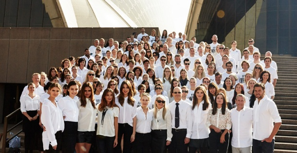 People wearing white shirts pose on the steps of the Sydney Opera House in support of ovarian cancer research. Photo: OCRF.