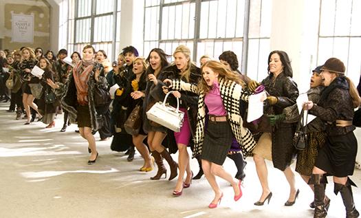 Instead of elbowing your way through the crowds, try shwopping with your friends! Image from Confessions of a Shopaholic.