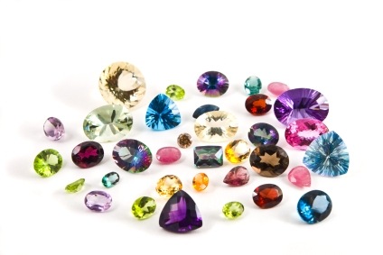 A grouping of different faceted gemstones. Photo via VIJI.