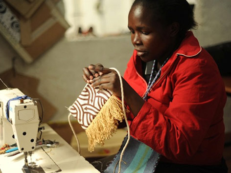 Kenyan artisan working with the UN-based Ethical Fashion Initiative. Photo by Tahir Karmali.