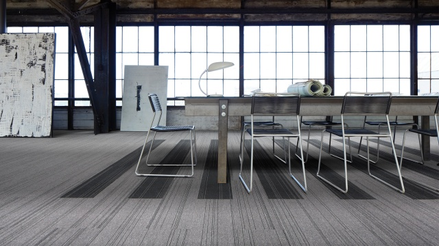 Office space covered with Interface carpet tiles made from 100% recycled yarn.