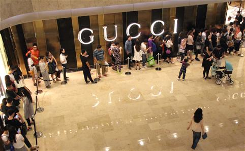 Queue outside the Gucci Shanghai store. Photo via The Time Out blog.