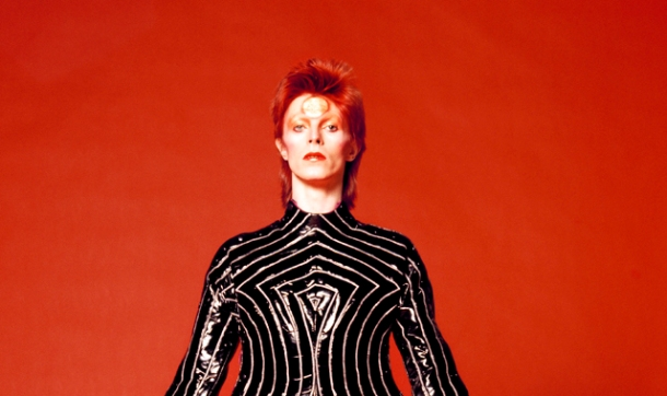 Bowie wearing a striped bodysuit for his 1973 Aladdin Sane Tour designed by Kansai Yamamoto Photo by Masayoshi Sukita.