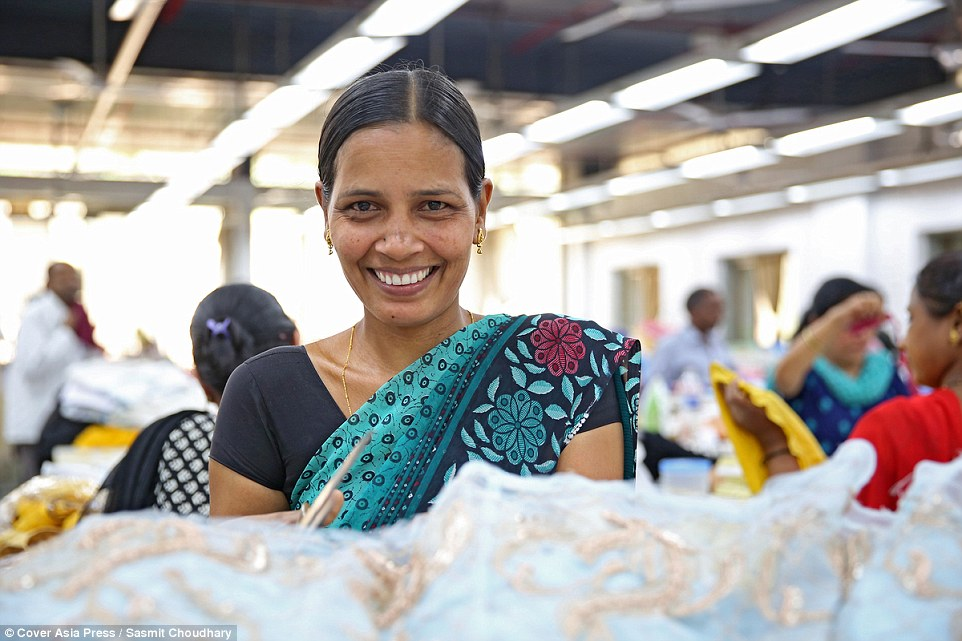 Happy: Babita (pictured) said she doesn't feel envious of famous people wearing the dresses she makes but can't afford. 'I love my work so I am happy that people on the other side of the world enjoy what we make,' she told MailOnline Photo via MailOnline